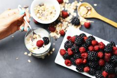 Preparing a healthy granola for breakfast with healthy ingredients royalty free stock photography