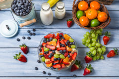 Preparing a healthy spring fruit salad royalty free stock photo