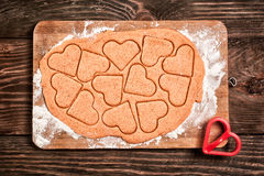 Preparing heart shaped cookies Stock Image