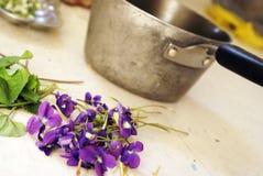 Preparing Herbal Dwarf Iris. A closeup view of some fresh picked Dwarf Iris being prepared for herbal uses Stock Photos
