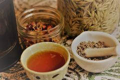 Preparing herbal teas stock images