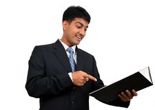 Preparing for higher education. Young Indian business man studying from a book Stock Photos