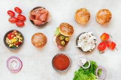 Preparing homemade burgers, various fillings Royalty Free Stock Image