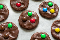 Preparing homemade chocolate cookies decorated with colored candy drops Stock Photography
