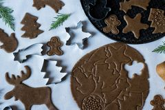Preparing homemade cookies for Christmas in different shapes,work in progress. Traditional dessert. Holiday background. Top view royalty free stock photos