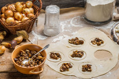 Preparing homemade dumplings with wild mushrooms Royalty Free Stock Photo