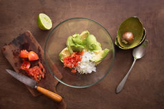 Preparing homemade guacamole on wooden table Stock Photos