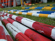 Preparing horse race. Colorful poles for horse race waiting on the grass Royalty Free Stock Photos