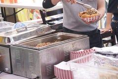 Preparing a hot dog Royalty Free Stock Photo