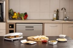 Preparing hot sandwiches in a sandwich maker royalty free stock photography