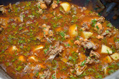 Preparing a hungarian goulash cooked in a stew-pot Stock Photography