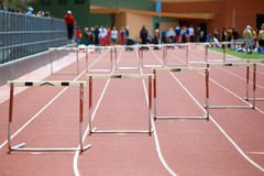 Preparing for a hurdles race. At a high school track and field meet Stock Images