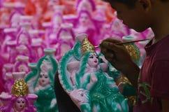Preparing Idol of goddess Lakshmi. Artist preparing goddess Lakshmi Idols for Diwali celebration. Goddess Lakshmi is the goddess of wealth Stock Images