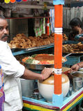 Preparing Indian fast food lunch Royalty Free Stock Images
