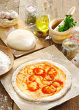Preparing an Italian pizza Royalty Free Stock Photo