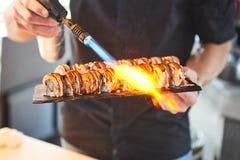 preparing japanese food sushi by sushi master royalty free stock photography