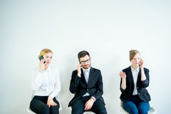 Preparing for a job interview. Three candidates are preparing for a job interview Stock Photography