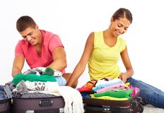 Preparing for a journey. Portrait of cute girl and handsome men preparing for journey Royalty Free Stock Image