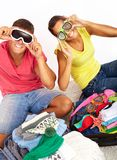 Preparing for journey. Portrait of cute girl and handsome men looking at camera through sport glasses while preparing for journey Stock Image