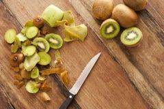 Preparing kiwifruit for a delicious dessert Royalty Free Stock Photos