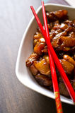 Preparing Korean food. Preparing Asian (oriental, Korean) food - bowl of chicken meat in soy sauce ready to be fried with red chopsticks Royalty Free Stock Photos