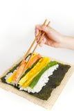 Preparing Korean Sushi. On white background Stock Photography
