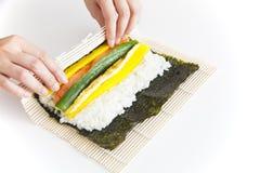 Preparing Korean Sushi. On white background Stock Photos
