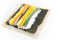 Preparing Korean Sushi. On white background Royalty Free Stock Photos