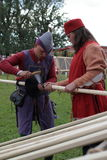 Preparing a lance for jousting. St. Petersburg, Russia - July 8, 2017: Participants preparing a lance for jousting tournament during the military history project Royalty Free Stock Photo