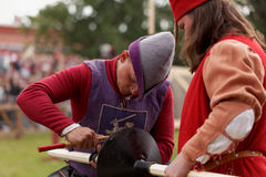 Preparing a lance for jousting. St. Petersburg, Russia - July 8, 2017: Participants preparing a lance for jousting tournament during the military history project Stock Photography
