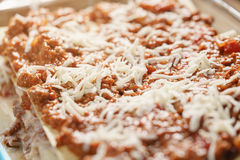 Preparing lasagna process on home kitchen for family dinner Royalty Free Stock Photos