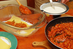 Preparing lasagna, ragu Royalty Free Stock Image