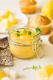 Preparing lemon cupcakes with citrus curd Stock Images
