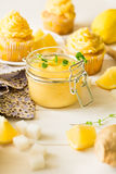 Preparing lemon cupcakes with citrus curd Royalty Free Stock Photography