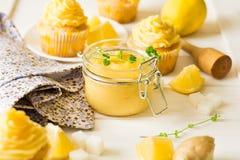 Preparing lemon cupcakes with citrus curd Stock Photography