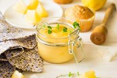 Preparing lemon cupcakes with citrus curd Stock Photos