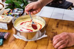 Free Preparing Lemon Curd Cheesecake With Strawberries Stock Images - 69820344
