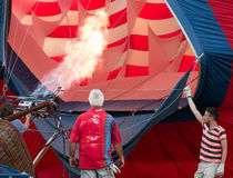 Preparing for liftoff. A flight crew begins to fill the balloon with hot air for an evening lift off at the 2015 New Jersey Festival of Ballooning. The festival Royalty Free Stock Photo