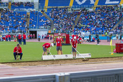 Preparing the long jump pit. On Diamond League in Rome, Italy in 2016nn Stock Photography