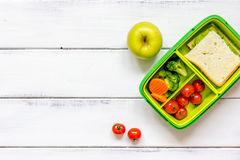 Preparing lunch for child school top view on wooden background Royalty Free Stock Image