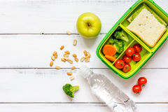 Preparing lunch for child school top view on wooden background Stock Image