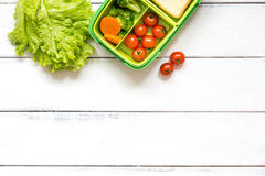 Preparing lunch for child school top view on wooden background. Preparing lunch for child with vegetables and fruit to school top view on wooden background Stock Photography