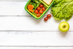 Preparing lunch for child school top view on wooden background Royalty Free Stock Photo
