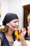 Preparing make up to actress before scene Royalty Free Stock Photos