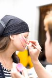Preparing make up to actress before scene Royalty Free Stock Photography