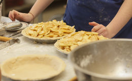 Preparing and making apple pies Royalty Free Stock Images