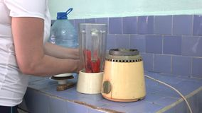 Preparing a mamey or sapote milk shake in Cuba stock video