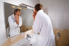 Preparing of man for going out Royalty Free Stock Photography