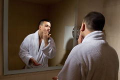 Preparing of man for going out Royalty Free Stock Photo