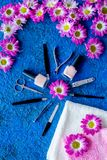 Preparing for manicure. Tools and nail polishes on blue background top view copyspace Royalty Free Stock Image